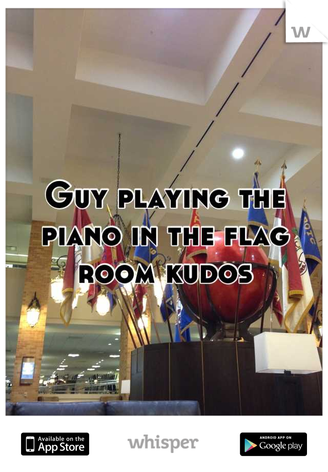 Guy playing the piano in the flag room kudos