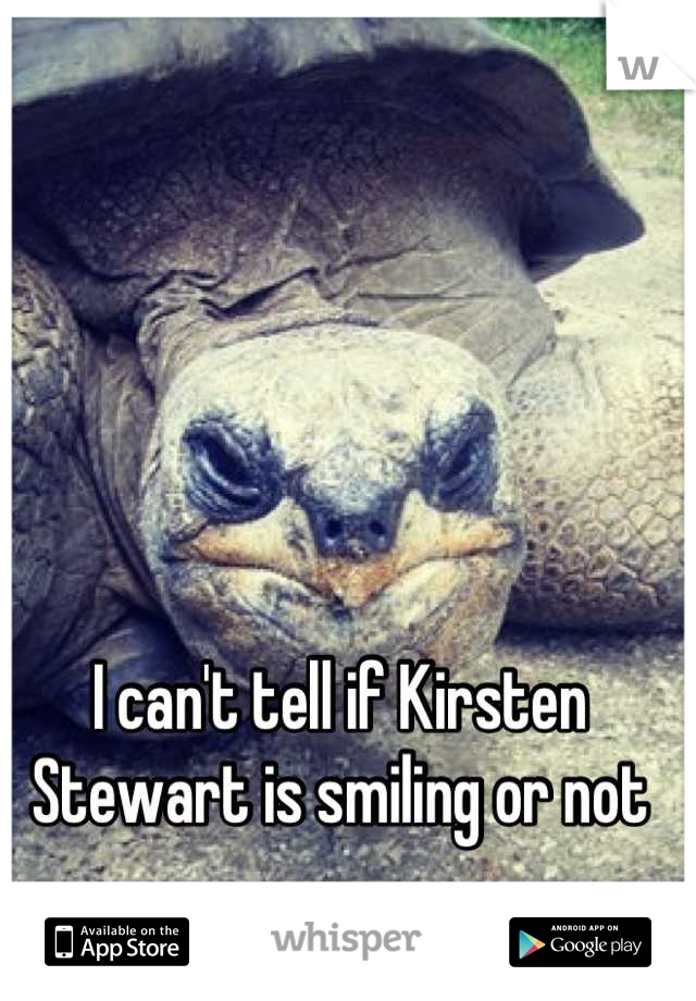 I can't tell if Kirsten Stewart is smiling or not