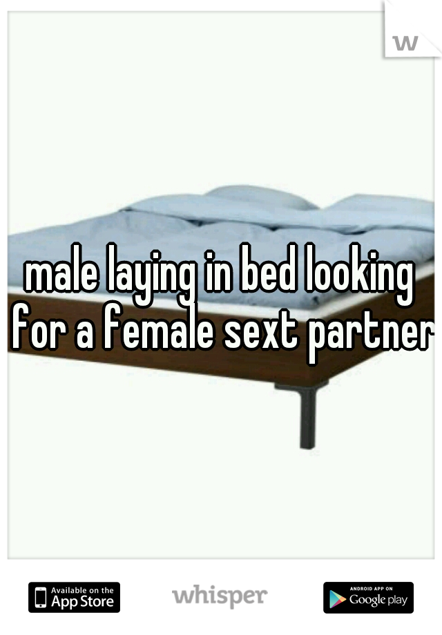 male laying in bed looking for a female sext partner
