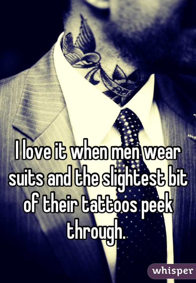 I love it when men wear suits and the slightest bit of their tattoos peek through.