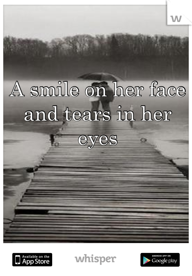 A smile on her face and tears in her eyes