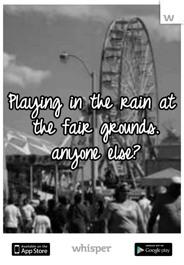 Playing in the rain at the fair grounds. anyone else?