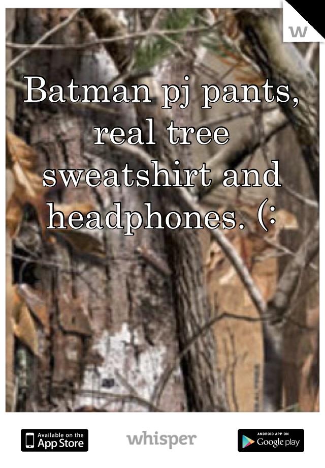 Batman pj pants, real tree sweatshirt and headphones. (: