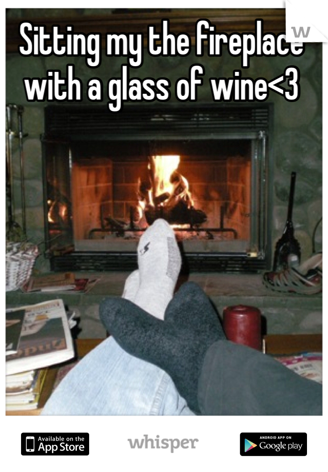 Sitting my the fireplace with a glass of wine<3