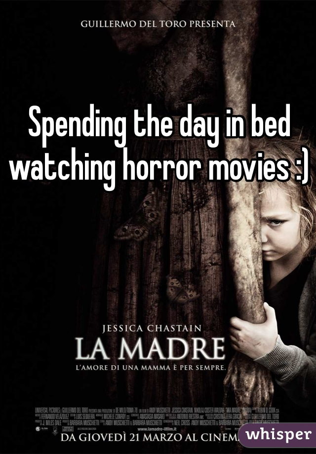 Spending the day in bed watching horror movies :)