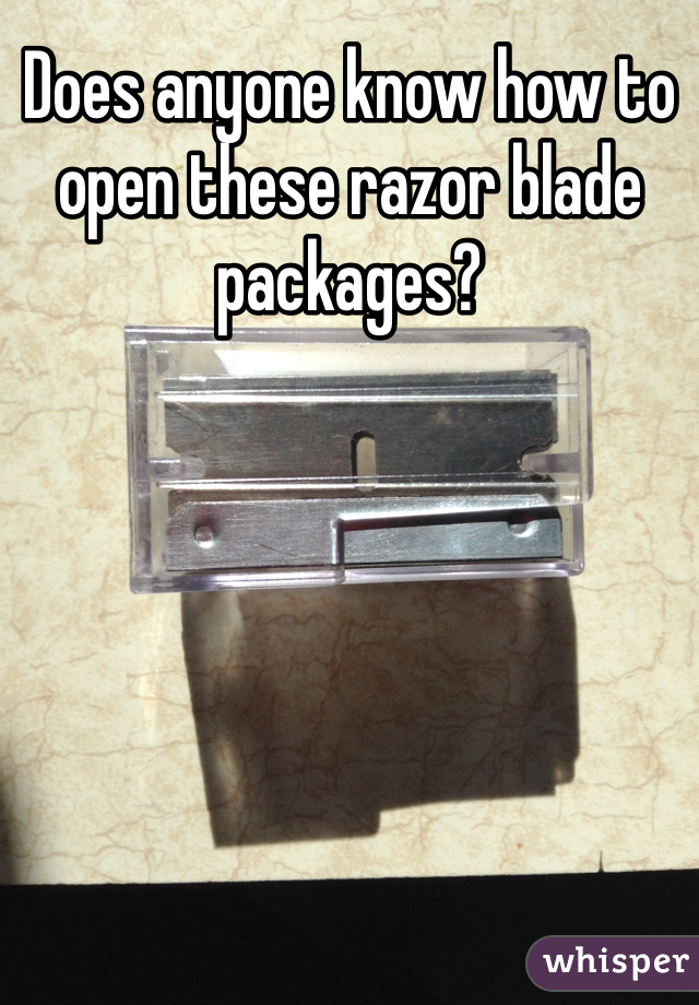 Does anyone know how to open these razor blade packages?