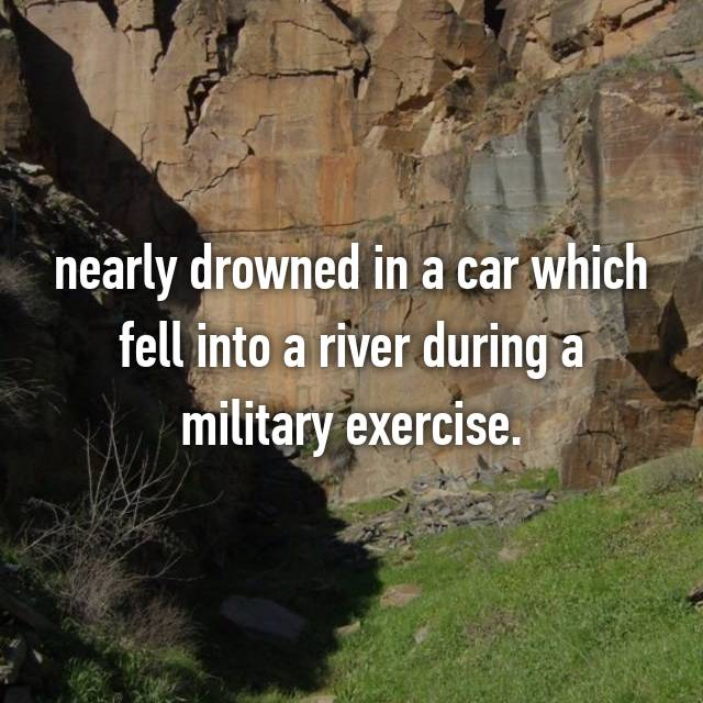 nearly drowned in a car which fell into a river during a military exercise.