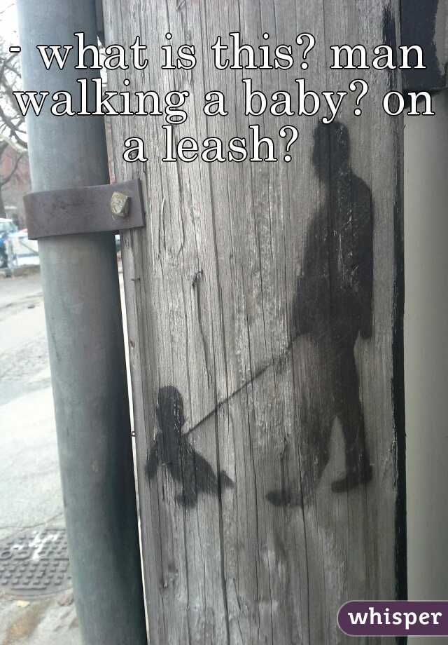 - what is this? man walking a baby? on a leash?