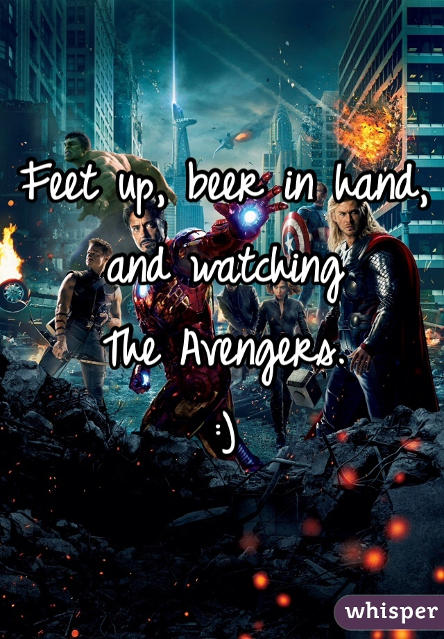 Feet up, beer in hand, and watching The Avengers. :)