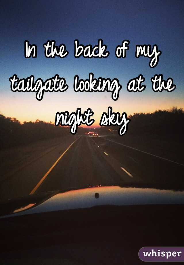 In the back of my tailgate looking at the night sky