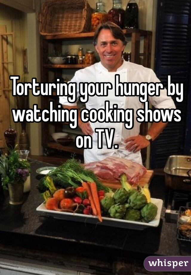 Torturing your hunger by watching cooking shows on TV.