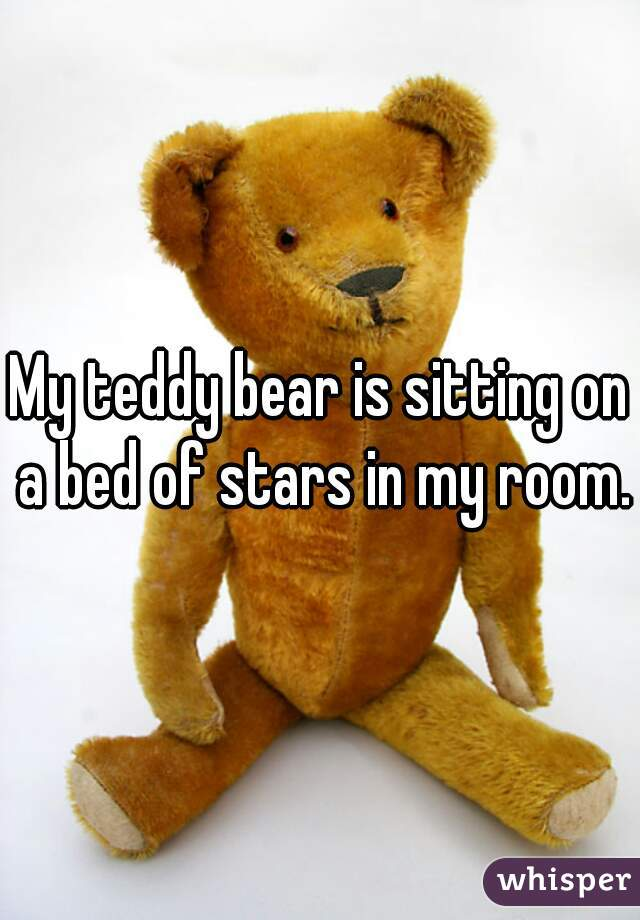 My teddy bear is sitting on a bed of stars in my room.