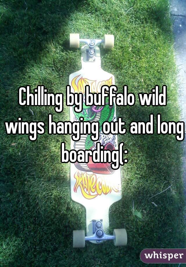 Chilling by buffalo wild wings hanging out and long boarding(: