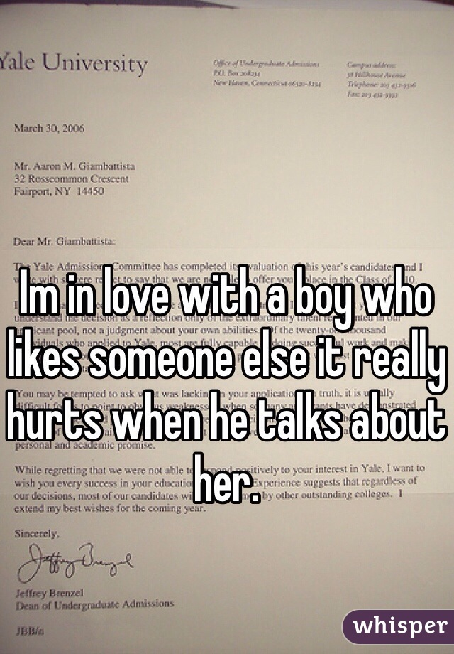 Im in love with a boy who likes someone else it really hurts when he talks about her.