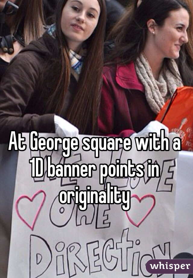 At George square with a 1D banner points in originality