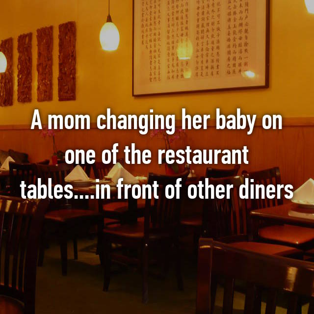 A mom changing her baby on one of the restaurant tables....in front of other diners