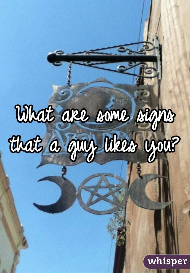 What are some signs that a guy likes you?
