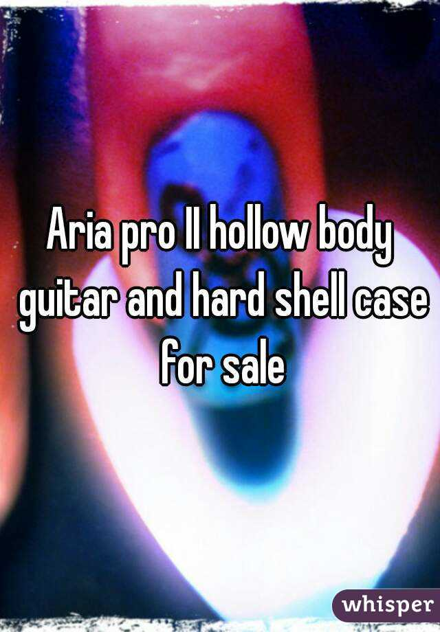 Aria pro II hollow body guitar and hard shell case for sale
