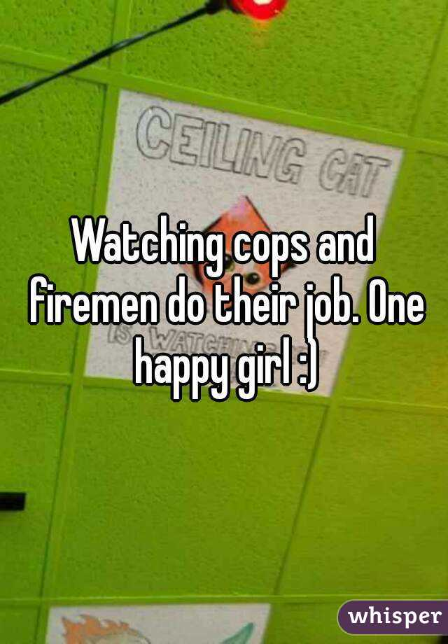 Watching cops and firemen do their job. One happy girl :)
