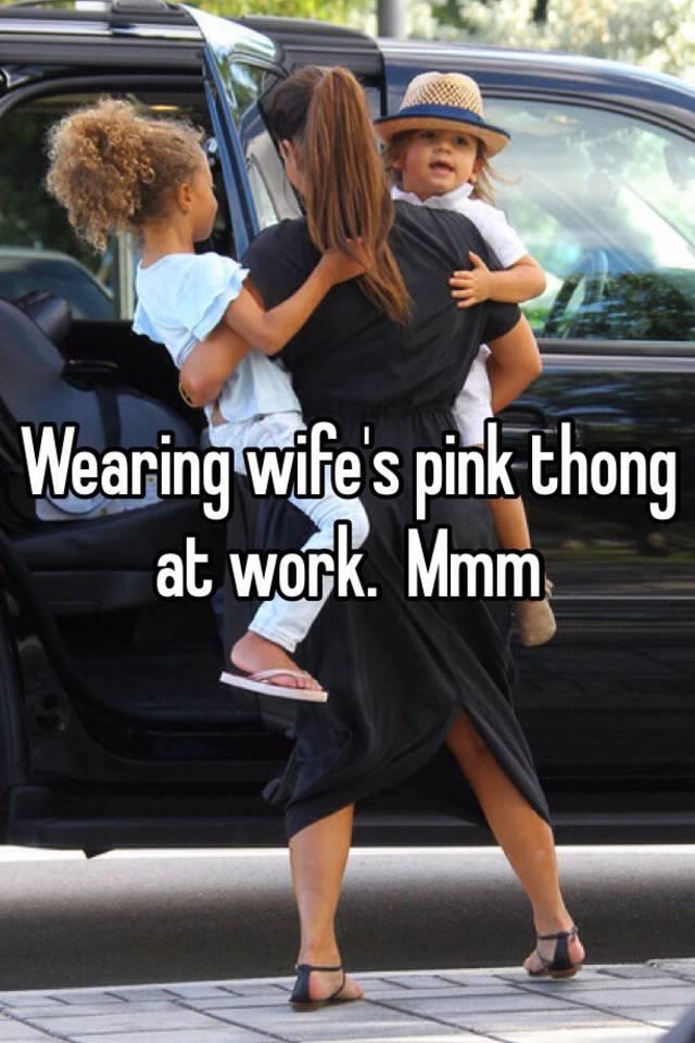 Wearing wifes pink thong at work. Mmm