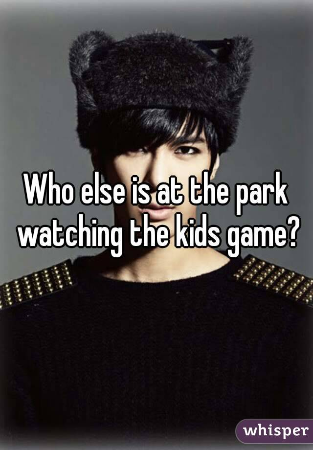 Who else is at the park watching the kids game?