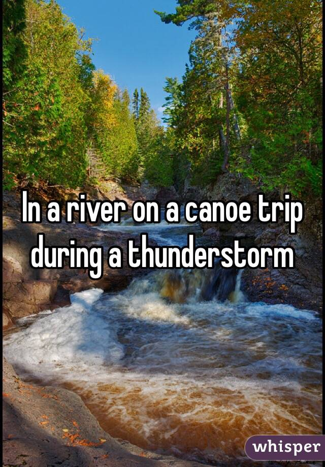 In a river on a canoe trip during a thunderstorm