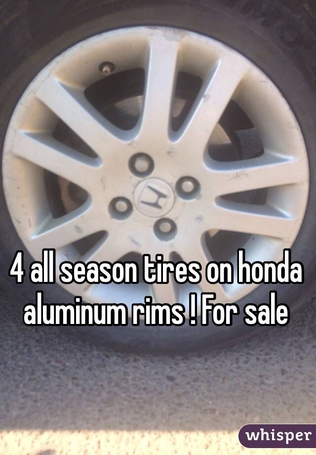 4 all season tires on honda aluminum rims ! For sale