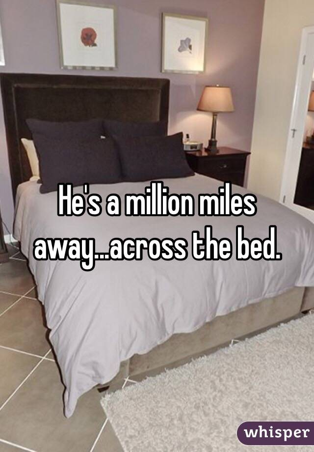 He's a million miles away...across the bed.