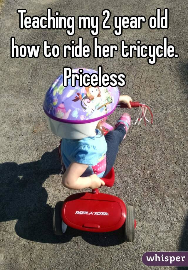 Teaching my 2 year old how to ride her tricycle. Priceless