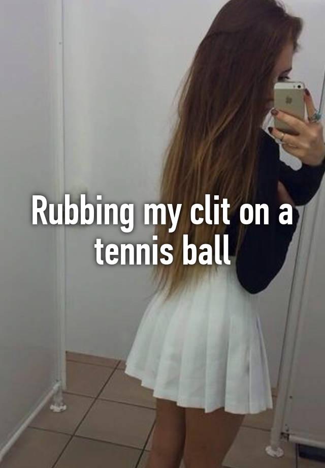 Rubbing my clit on a tennis ball