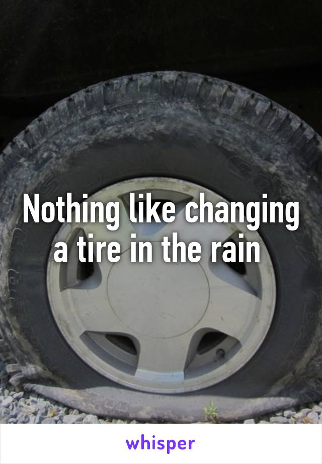 Nothing like changing a tire in the rain