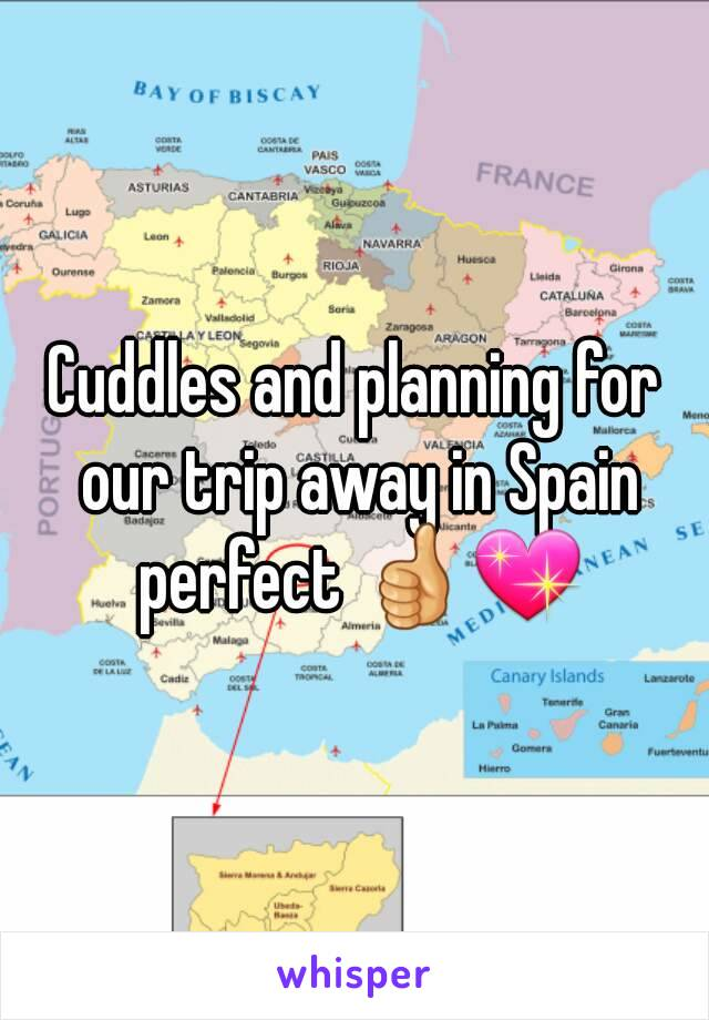Cuddles and planning for our trip away in Spain perfect 👍💖