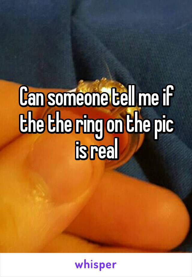 Can someone tell me if the the ring on the pic is real