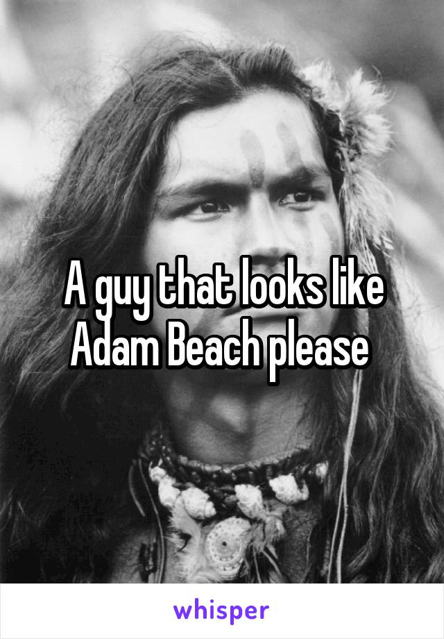 A guy that looks like Adam Beach please