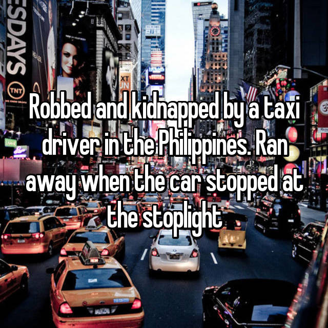 Robbed and kidnapped by a taxi driver in the Philippines. Ran away when the car stopped at the stoplight