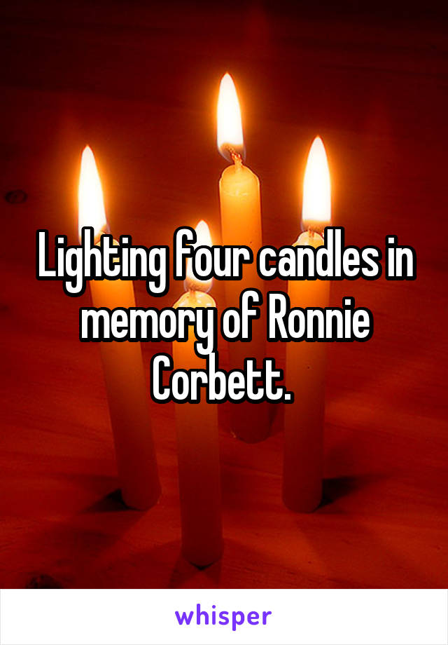 Lighting four candles in memory of Ronnie Corbett.