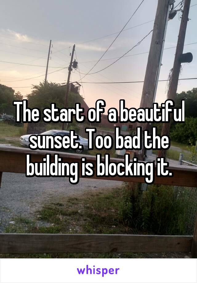 The start of a beautiful sunset. Too bad the building is blocking it.