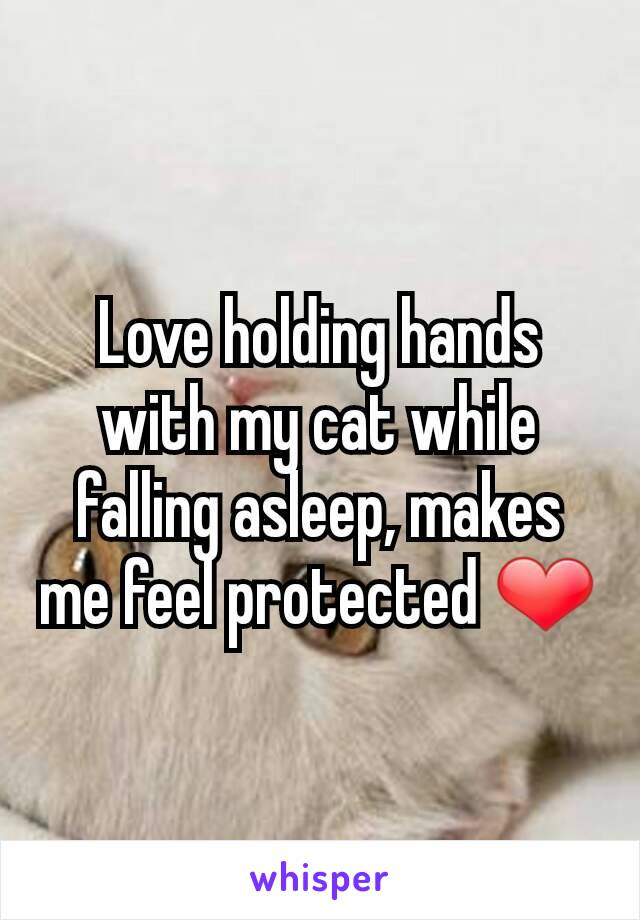 Love holding hands with my cat while falling asleep, makes me feel protected ❤
