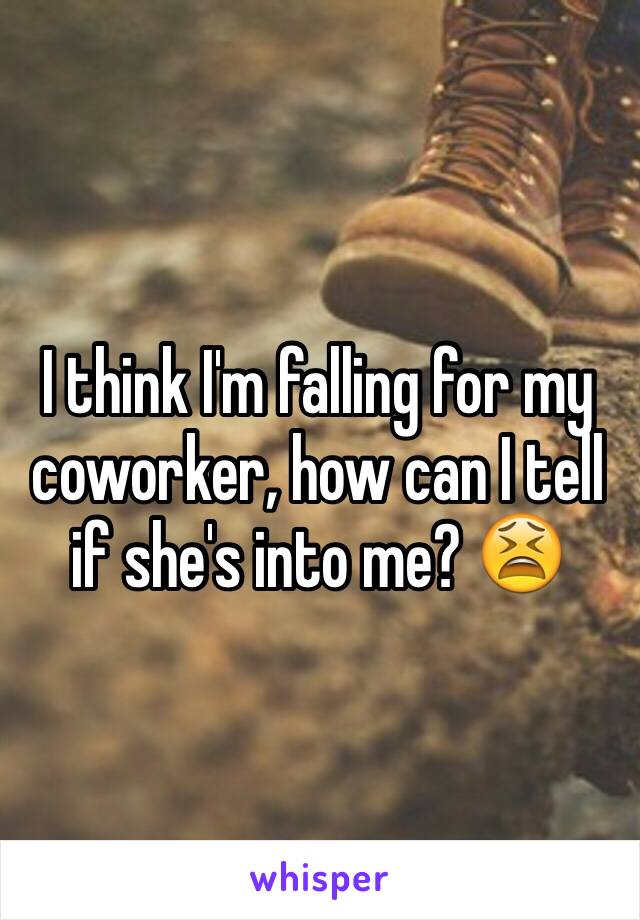 I think I'm falling for my coworker, how can I tell if she's into me? 😫