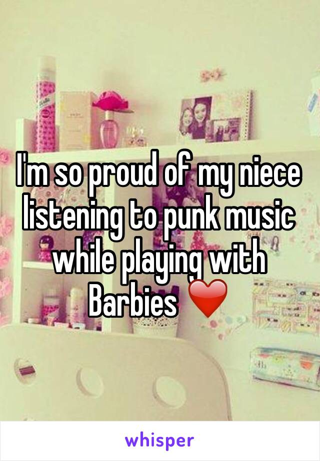 I'm so proud of my niece listening to punk music while playing with Barbies ❤️