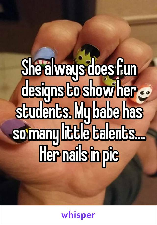 She always does fun designs to show her students. My babe has so many little talents.... Her nails in pic