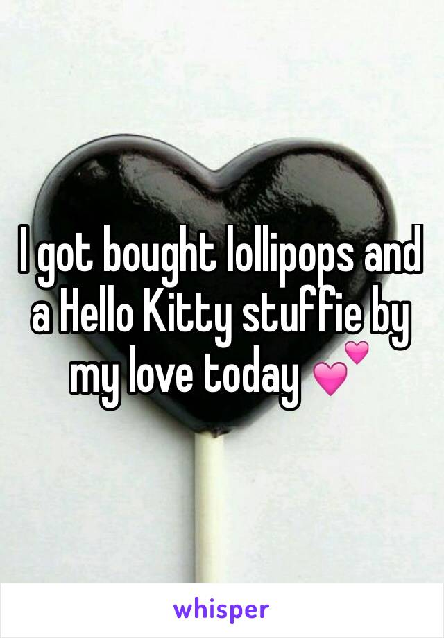 I got bought lollipops and a Hello Kitty stuffie by my love today 💕