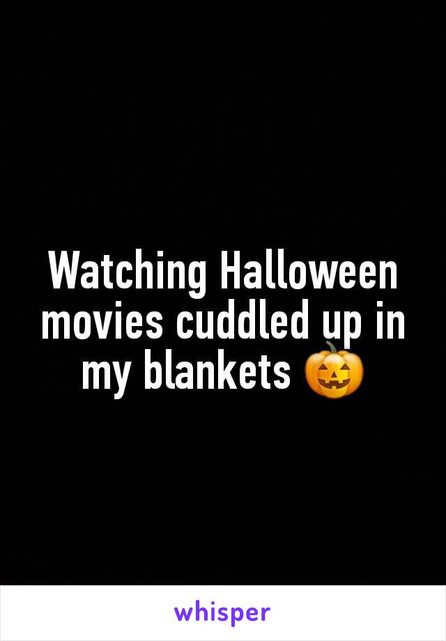 Watching Halloween movies cuddled up in my blankets 🎃