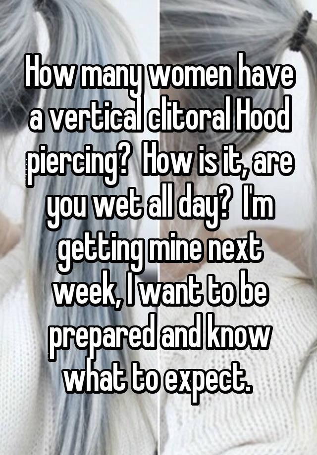Vertical clitorial hood piercing