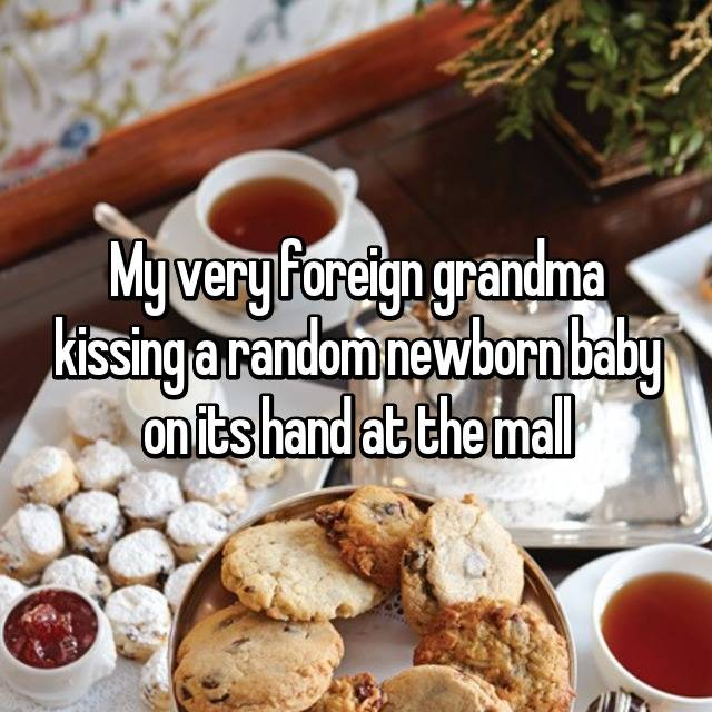 My very foreign grandma kissing a random newborn baby on its hand at the mall