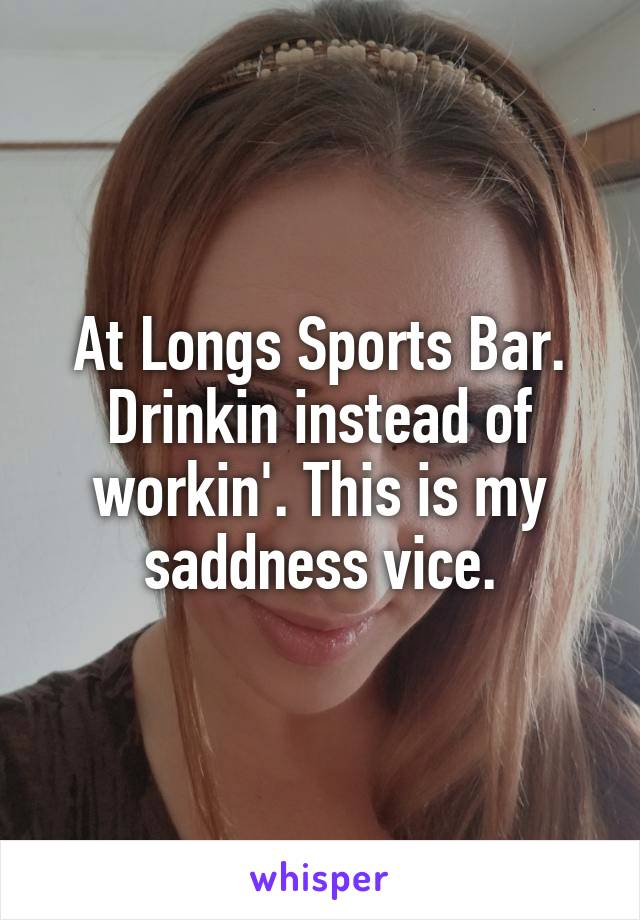 At Longs Sports Bar. Drinkin instead of workin'. This is my saddness vice.