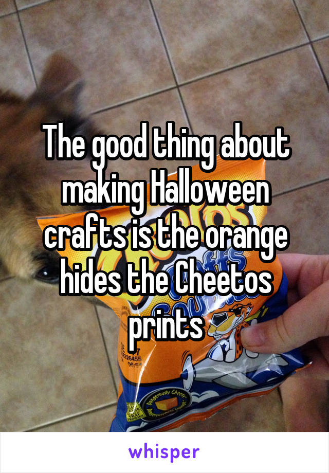 The good thing about making Halloween crafts is the orange hides the Cheetos prints