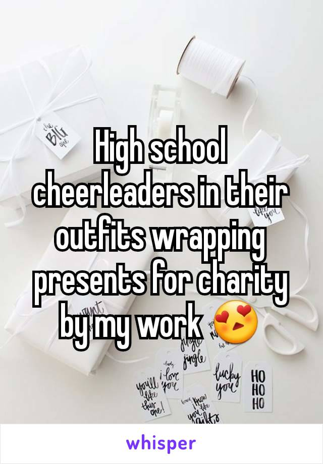 High school cheerleaders in their outfits wrapping presents for charity by my work 😍