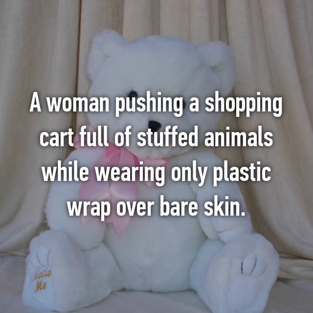 A woman pushing a shopping cart full of stuffed animals while wearing only plastic wrap over bare skin.