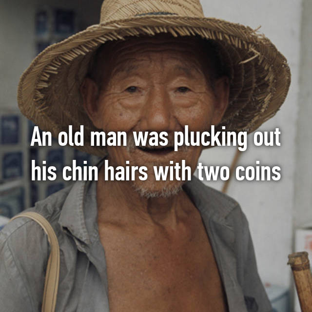 An old man was plucking out his chin hairs with two coins